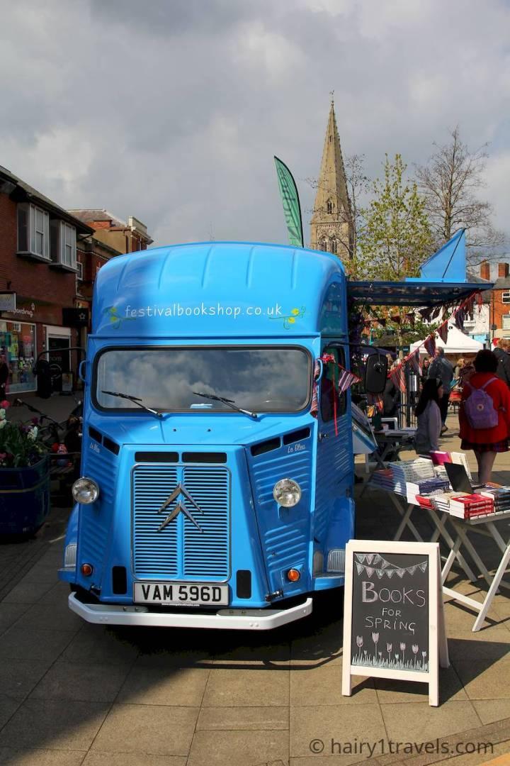 Distinctive blue Citroen van of the Festival Bookshop. Holistic harborough Festival in The Squaare.