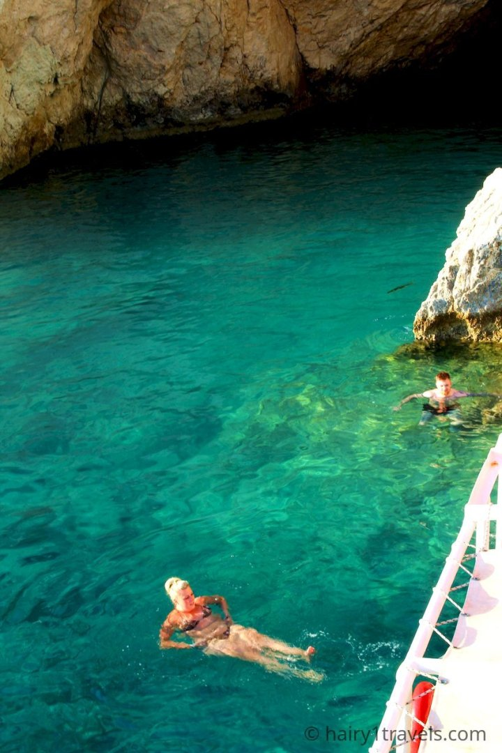 Swimming in the clear waters at a cave on Turtle Island