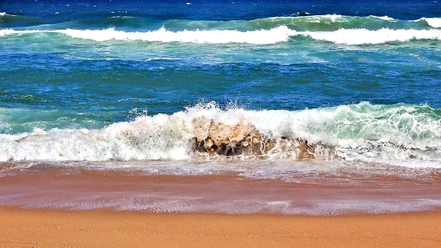 Breaking waves on a sandy beach at Umhlanga.