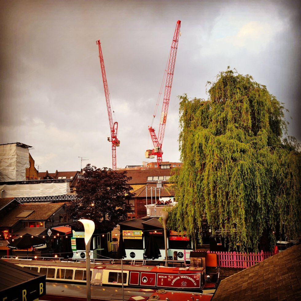 Camden - cranes and trees and boats in a view from a Camden Market Pub