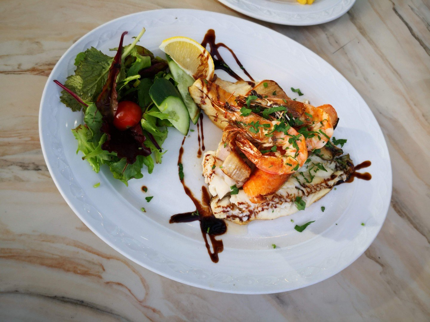 Four type of fish on a plate at Barracuda Brasserie, Brighton Marina