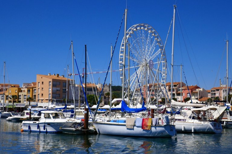 Boats and a big wheel in Athe Harbour at Agde.