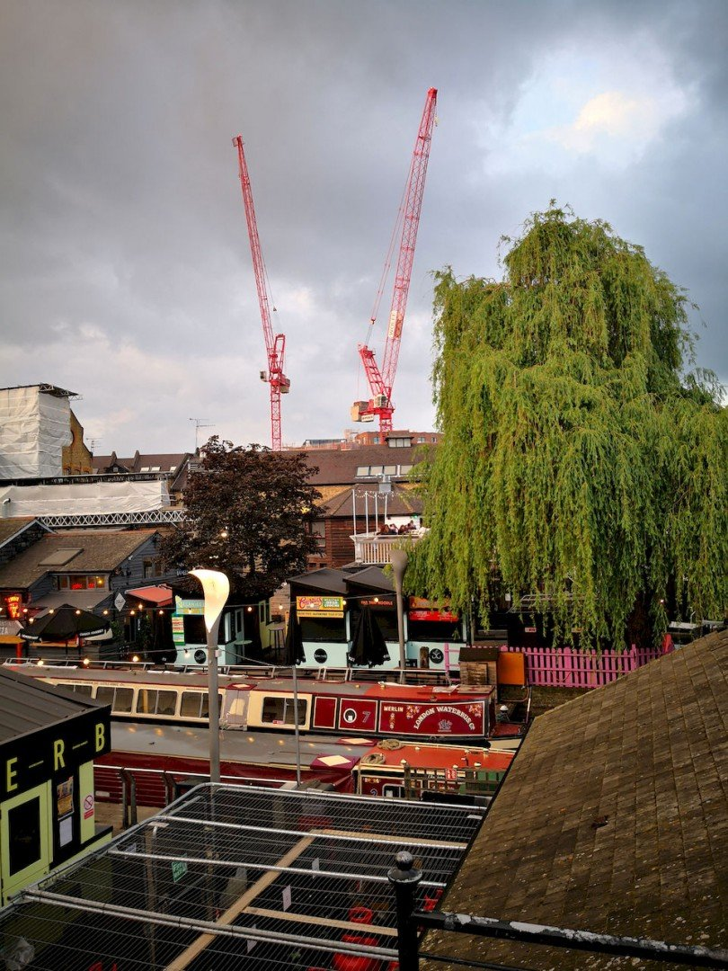 Cranes and narrow boats in the sundown light at Camden Market.