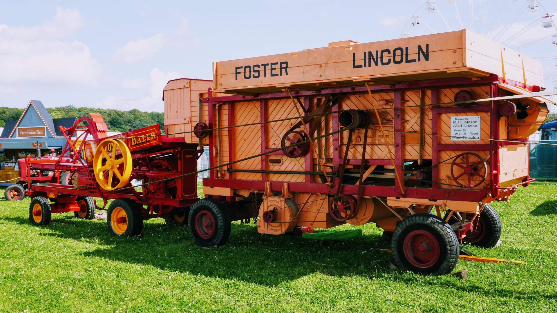 Thresher being driven by a steam engine