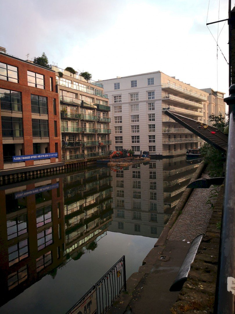 Reflection in the canal near Camden Lock in the early evening light.