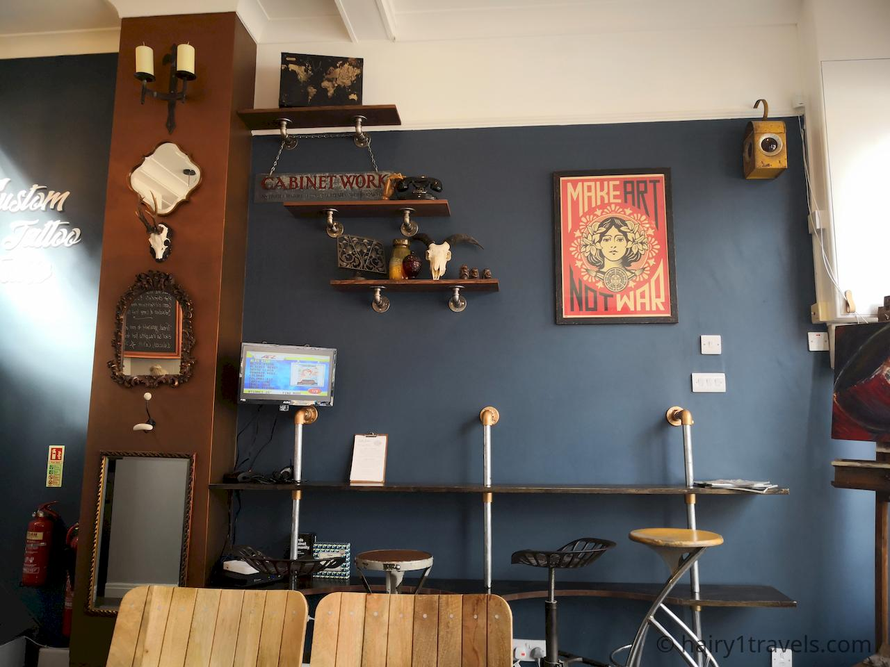 Interest wall in the coffee lounge at Capulus et Artem in Market Harborough.