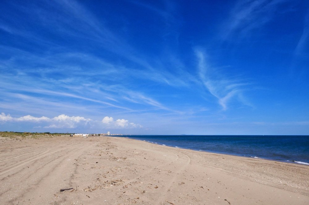 A view of Beach and sky with Valras Plage on the horizon. Near Blue Bayou.