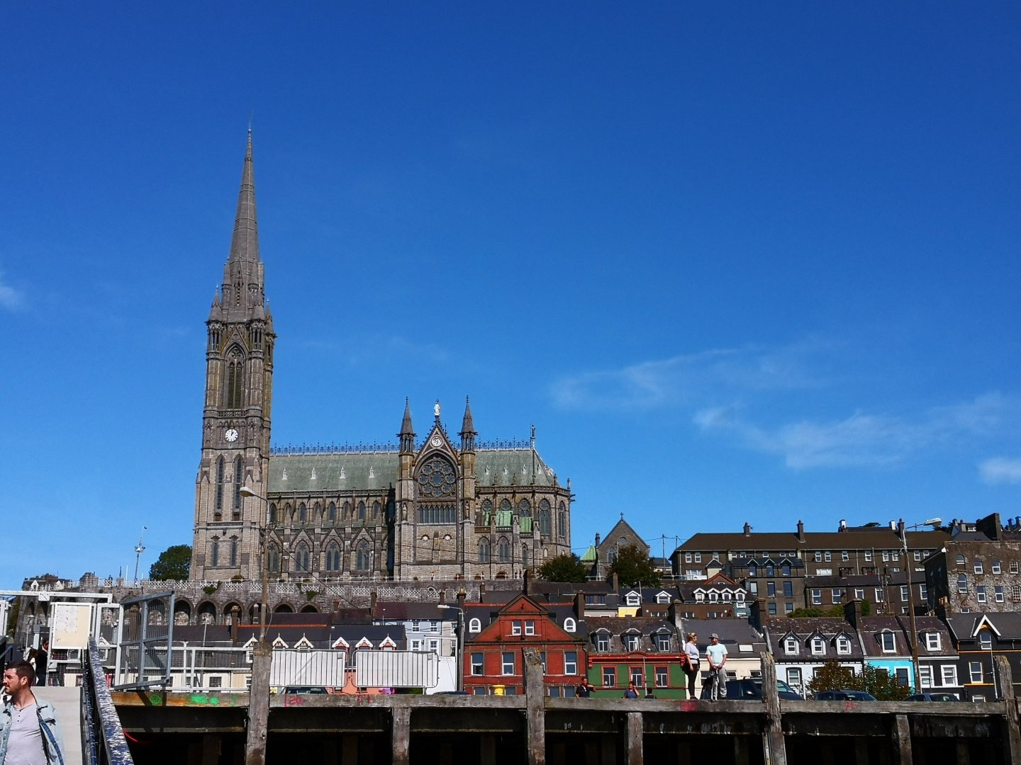 St Colmans Cathedral dominates the skyline at Cobh in Ireland as we approach across Cork Harbour.