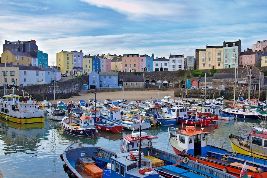 Tenby colours. The many colours of the buildings contrast with the colours of the boats in the harbour.