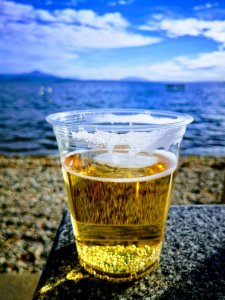 A cold beer on a warm Saturday at Perroy beach, Switzerland.