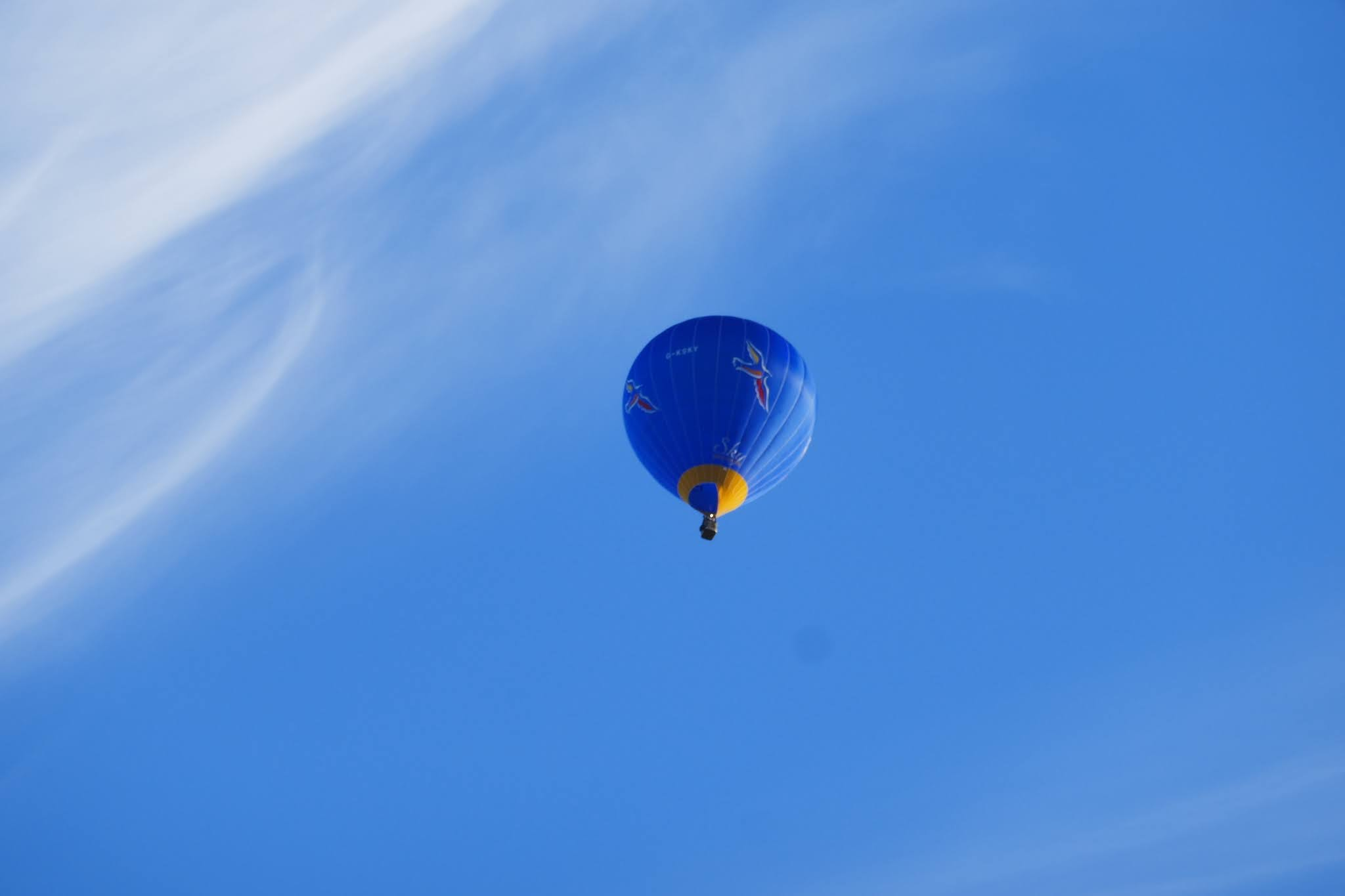 A Ballon just appeared in the blue sky while we were having a braai.